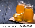 honey with wooden honey dipper... | Shutterstock . vector #1043766889
