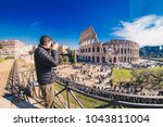 tourist taking pictures at the... | Shutterstock . vector #1043811004