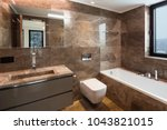 luxurious marble bathroom with... | Shutterstock . vector #1043821015