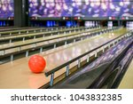 orange ball on bowling alley | Shutterstock . vector #1043832385