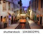 lisbon yellow tram funicular in ... | Shutterstock . vector #1043832991