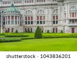 a beautiful lawn and building. | Shutterstock . vector #1043836201