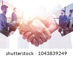 abstract handshake on meeting... | Shutterstock . vector #1043839249
