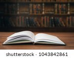 open book on the desk in the... | Shutterstock . vector #1043842861