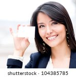 Friendly woman holding a business card and smiling - stock photo