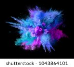Explosion of blue, aqua and violet dust on black background. Illustration