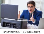 businessman angry at copying... | Shutterstock . vector #1043885095