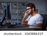 young man staying late in... | Shutterstock . vector #1043886319