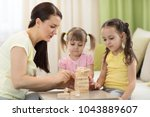 family mom and daughters at the ... | Shutterstock . vector #1043889607