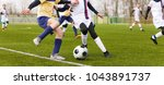 two youth footballers running... | Shutterstock . vector #1043891737