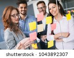 group of business people... | Shutterstock . vector #1043892307