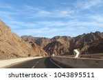 road in the mountains of dahab. ... | Shutterstock . vector #1043895511