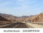 road in the mountains of dahab. ... | Shutterstock . vector #1043895544