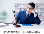 young lawyer judge sitting in... | Shutterstock . vector #1043896069