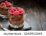 chocolate dessert in glasses... | Shutterstock . vector #1043911045