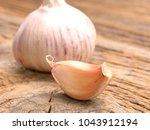 garlic on a old wooden...   Shutterstock . vector #1043912194