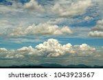 scenic view of various cloud... | Shutterstock . vector #1043923567