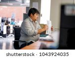 employees man are preparing... | Shutterstock . vector #1043924035