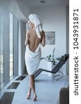 young woman relaxed after shower | Shutterstock . vector #1043931871