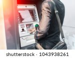 Hand Businessman Typing On Atm...