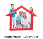 Young family with two kids holding house sign - new home concept, isolated - stock photo