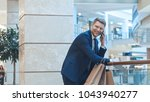young smiling businessman... | Shutterstock . vector #1043940277