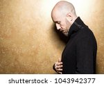 fashion portrait of a 40 year... | Shutterstock . vector #1043942377