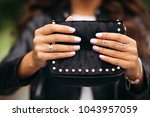 close up of unrecognizable... | Shutterstock . vector #1043957059