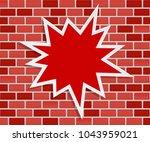 splash star on brick wall  ... | Shutterstock .eps vector #1043959021