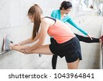 sportswomen stretching after... | Shutterstock . vector #1043964841