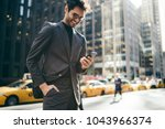 happy male entrepreneur in... | Shutterstock . vector #1043966374