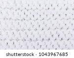 the texture of the crochet ... | Shutterstock . vector #1043967685