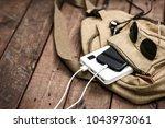 charging the empty battery... | Shutterstock . vector #1043973061