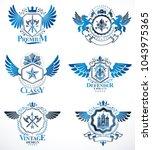 vintage heraldry design... | Shutterstock .eps vector #1043975365