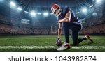 american football player in...   Shutterstock . vector #1043982874