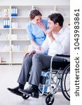 disabled patient on wheelchair... | Shutterstock . vector #1043983861