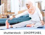arab woman doing gymnastics in... | Shutterstock . vector #1043991481