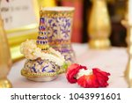 thai urn or ossuary with red... | Shutterstock . vector #1043991601