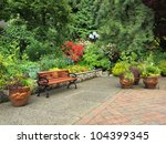 Garden Bench Surrounded By Lus...