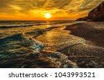 sunset mountain sea beach... | Shutterstock . vector #1043993521