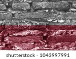 polish flag on an old brick wall | Shutterstock . vector #1043997991