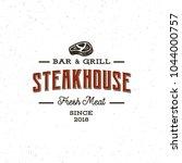vintage steak house logo. retro ... | Shutterstock .eps vector #1044000757