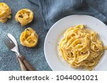 portion of fettuccine alfredo | Shutterstock . vector #1044001021