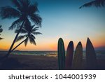 silhouette surfboard on... | Shutterstock . vector #1044001939