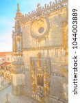Small photo of Tomar, Portugal - August 10, 2017: Cloister of Santa Barbara with Chapter window or Janela do Capitulo in Manueline style of Diogo de Arruda. Convent of Christ in Templar Castle. Aerial view.