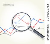 magnifying glass over charts  ... | Shutterstock .eps vector #1044022765