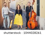 A Musical Group Of Three Peopl...