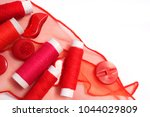 red sewing thread on a white... | Shutterstock . vector #1044029809