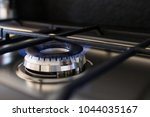 gas cooker with lit blue flame. ... | Shutterstock . vector #1044035167