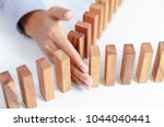 businessman hand project wooden ... | Shutterstock . vector #1044040441